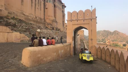 amer fort : Jaipur, India, November 05, 2019, Amer Fort tourists descend the old streets of the fort part 2 4K