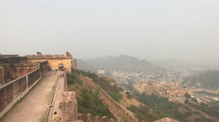 âmbar : Jaipur, India - November 03, 2019: Jaigarh Fort tourists walk along the walls of the old fortress on top of the mountain part 9 4K