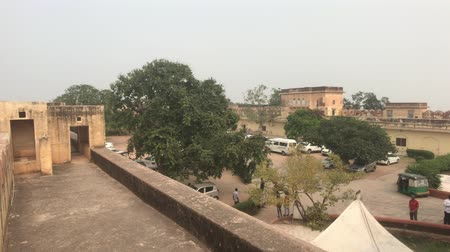 geliştirmek : Jaipur, India - November 03, 2019: Jaigarh Fort tourists walk in the courtyard of the old fortress part 3 4K Stok Video