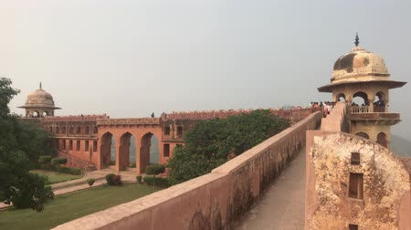 geliştirmek : Jaipur, India - November 03, 2019: Jaigarh Fort tourists look down from the height of the walls part 2 4K