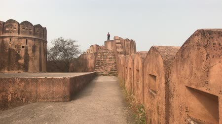 jaigarh : Jaipur, India - November 03, 2019: Jaigarh Fort tourists walking in the distance on the fortress wall part 4 4K