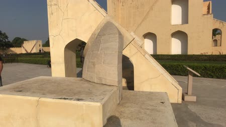 develop : Jaipur, India - November 04, 2019: Jantar Mantar tourists inspect historic buildings under the scorching sun part 14 4K