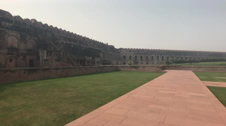 slum : Agra, India - Agra Fort, a long platform along the wall 4K