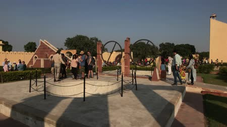geliştirmek : Jaipur, India - November 04, 2019: Jantar Mantar tourists walk around the territory of historical structures part 19 4K Stok Video