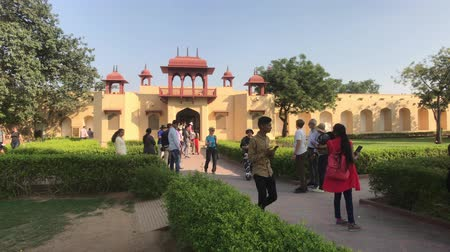 develop : Jaipur, India - November 04, 2019: Jantar Mantar tourists walk around the territory of historical structures part 2 4K