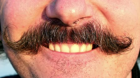 bigodes : Closeup of mans mustaches and mouth while laughing Vídeos