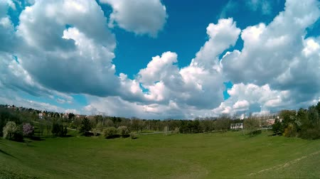 puffy clouds : White Fluffy Clouds Moving Over The Green Field in Timelapse video
