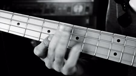 slapping : Bass Guitarist Playing Bass Guitar Close Up