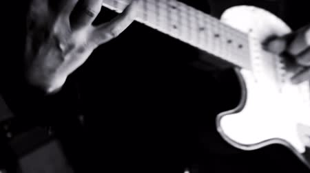 strum : Guitarist Playing Guitar in the Music Studio Stock Footage