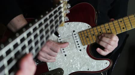 string instrument : Guitarist and Bassist Rehearsing in the Music Studio Stock Footage
