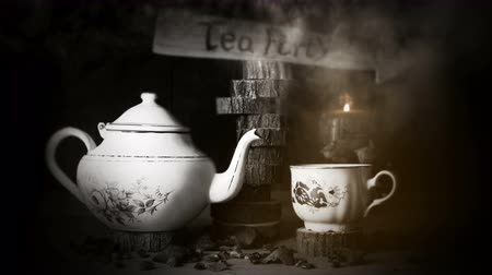 ramalhete : Cup of Tea and Teapot On Wooden Table With Arrow Sign, Smoke ,Candle Flame and Light