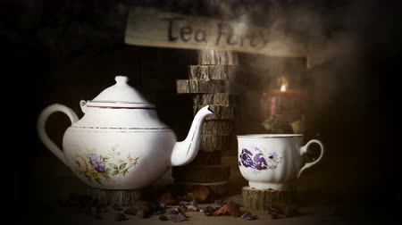 teacup : Cup of Tea and Teapot On Wooden Table With Arrow Sign, Smoke ,Candle Flame and Light