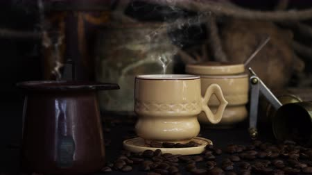 caffe : Coffee Cup Smoking Hot With Coffee Beans and Grinder On a Vintage Rustic Background Stock Footage