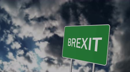geri çekilme : Brexit Concept. Great Britain Departing European Uniun. Brexit Road Sign Against Sky Background Stok Video