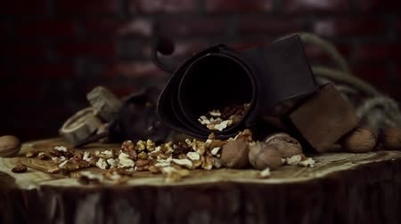kernels : Walnuts Falling in Slow Motion on Rustic Old Table with Vintage Hand Grinder