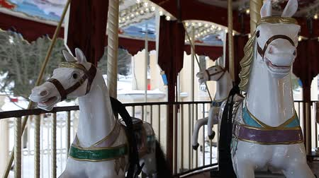 targi : Spinning county fair fairground merry-go-round at daytime in winter for Christmas holidays