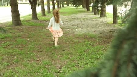 grass flowers : Girl hopping and runs away from camera