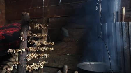 perkament : Porcini edible mushrooms Boletus Edulis being dried naturally by indoor open fire smoke in mountain hut