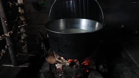 fireplace : Steaming pot over indoor fire in mountain hut