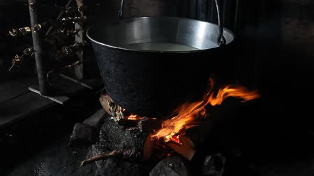 owsianka : Steaming pot over indoor fire in mountain hut