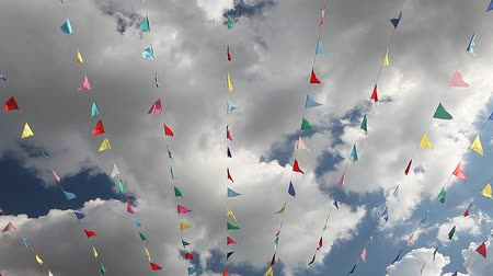 flapping : Carnival celebrate banner party flags against cloudy blue sky on windy day