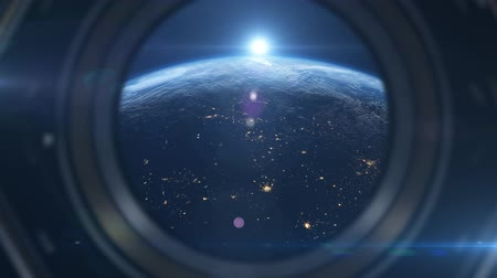 way out : Seeing planet earth sunrise from inside a space ship looking out a window 4k