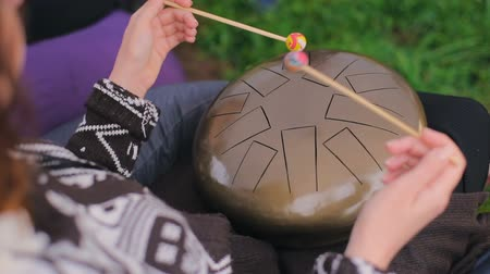 Woman playing hang drum Stock Footage