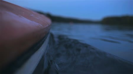 waterline : Canoe with surface split view. Low angle view of a canoe in the water Stock Footage