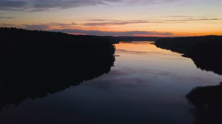 Aerial View. Flight over the river or lake after sunset. Nature background Stock Footage