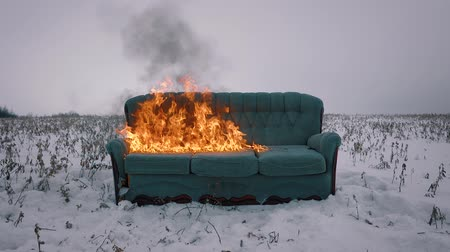 резидент : The sofa in the field is flammable. Incineration of furniture. Conceptual video.