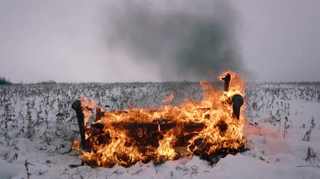 teljesen : Conceptual video. The sofa has completely burned down. Back fall Stock mozgókép