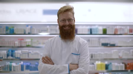 boticário : Portrait of an young pharmacist consultant is smiling in camera in a drug store Vídeos