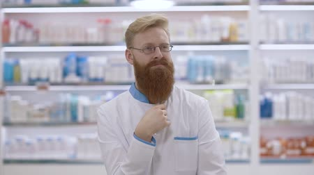mento : Smart and handsome doctor or pharmacist thinking