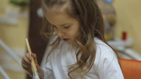 creativity : Girl draws paints on paper Stock Footage
