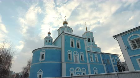 Domes of the Orthodox Church on the background of the blue sky. Smolensk Cathedral, Belgorod, Russia. Bottom view. 4K, 25 fps Wideo