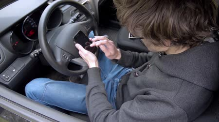 acabado : Man Working With a Phone in the Car