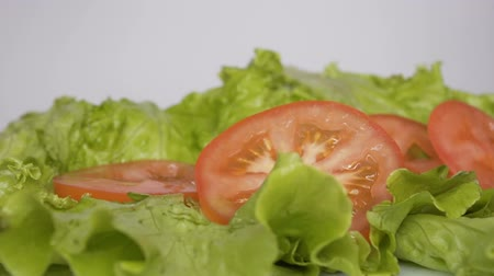 salad : Sliced Tomatoes Falling on Green Salad