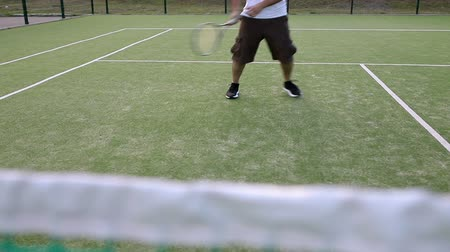 The player is preparing to hit the tennis ball