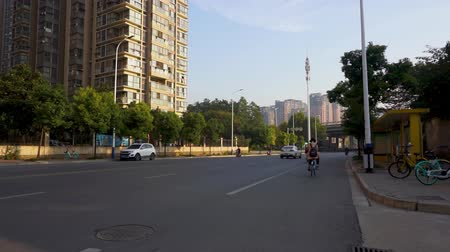 yoğunluk : Wuhu Anhui China Common Street with Low Intensity Traffic Car Mopeds and Motorbikes