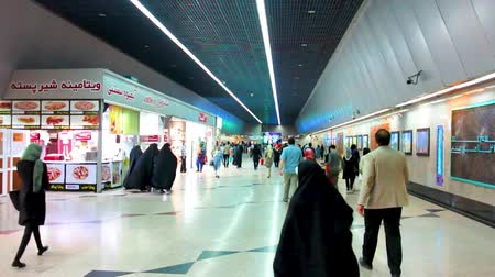 passagem : Tehran Subway Illuminated Underway Passage with Walking People and Shops