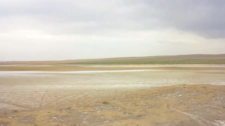 kumul : Kashan Maranjab Salt Desert with Tracks and Blue Sky Background