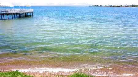 kul : Issyk Kul Lake Shore with Snow Capped Peaks at Horizon Stock Footage