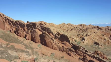 kul : Skazka Fairytale Canyon with Lake Issyk Kul Lake Horizon View Stock Footage