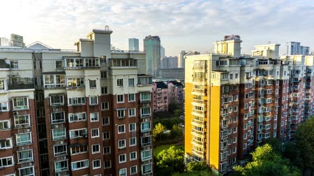 yoğunluk : Time Lapse Shanghai Multi Level Highrise Apartment Building with Sky Cloudy Background at Morning Stok Video