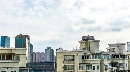 yoğunluk : Time Lapse Shanghai Multi Level Highrise Apartment Buildings with Cloudy Sky Background