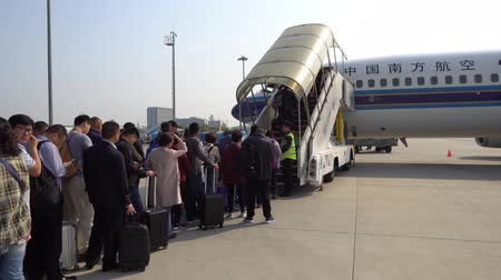 departing : At Nanjing Lukou Airport Passengers are Waiting Outside for Boarding the China Southern Airlines Plane