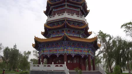 temyiz : Hotan Picturesque Kunlun Lake Park View of Pagoda with Cloudy Blue Sky at Background Stok Video