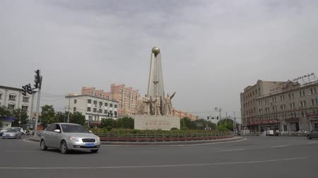 yosma : New Era New Hotan Stone Statue Of Uyghur People At Ring Road With A Cloudy Sky Background