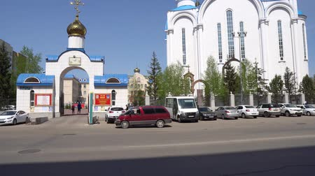 sobor : Nur-Sultan Astana Russian Orthodox Christian Assumption Cathedral Main Gate Entrance Street View on a Sunny Blue Sky Day