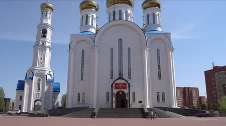 sobor : Nur-Sultan Astana Russian Orthodox Christian Assumption Cathedral Front View on a Sunny Blue Sky Day Stock Footage